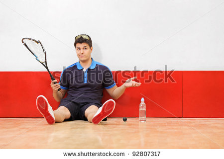 stock-photo-a-young-disappointed-squash-player-holding-a-broken-racket-in-a-squash-court-92807317